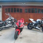 Motorcycles in front of Wood & Glass Garage Door